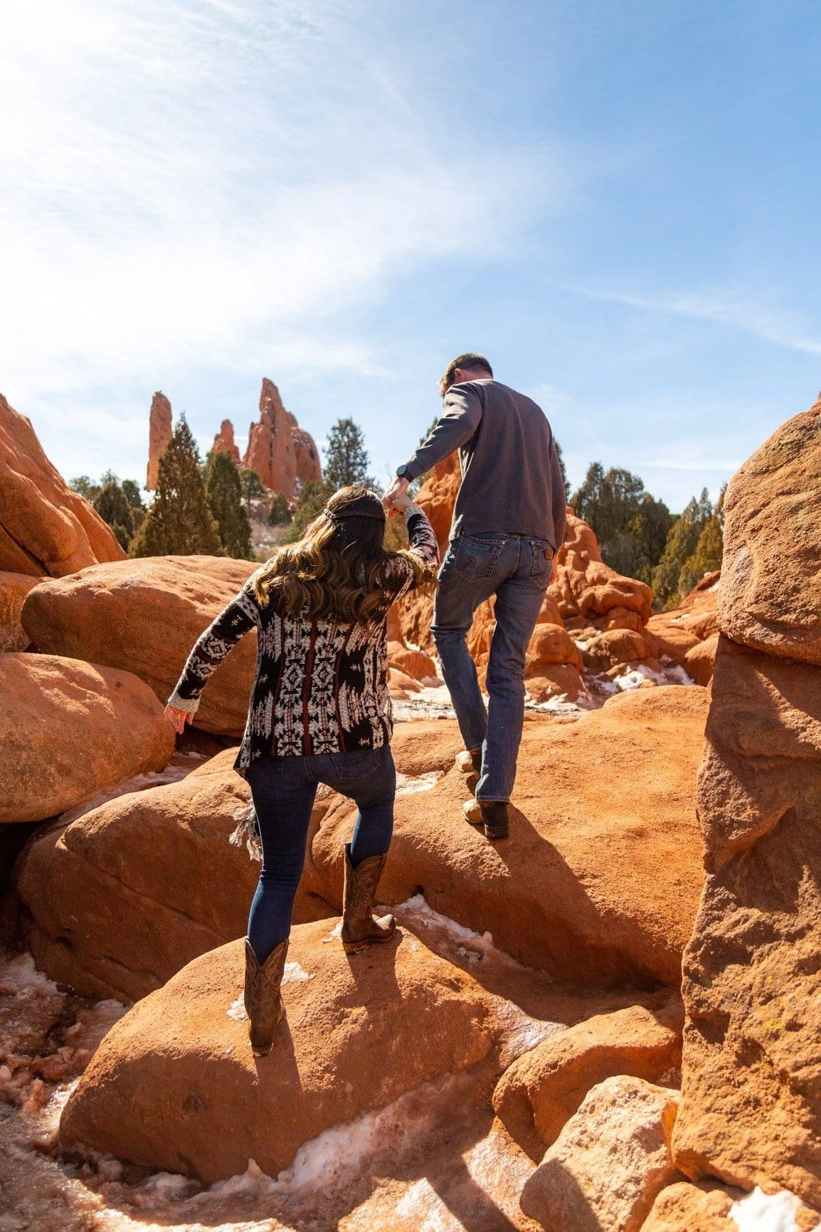 fiance leads his bride to be through the trails of Garden of the Gods during their adventure session. Trails are more fun when explored with those you love
