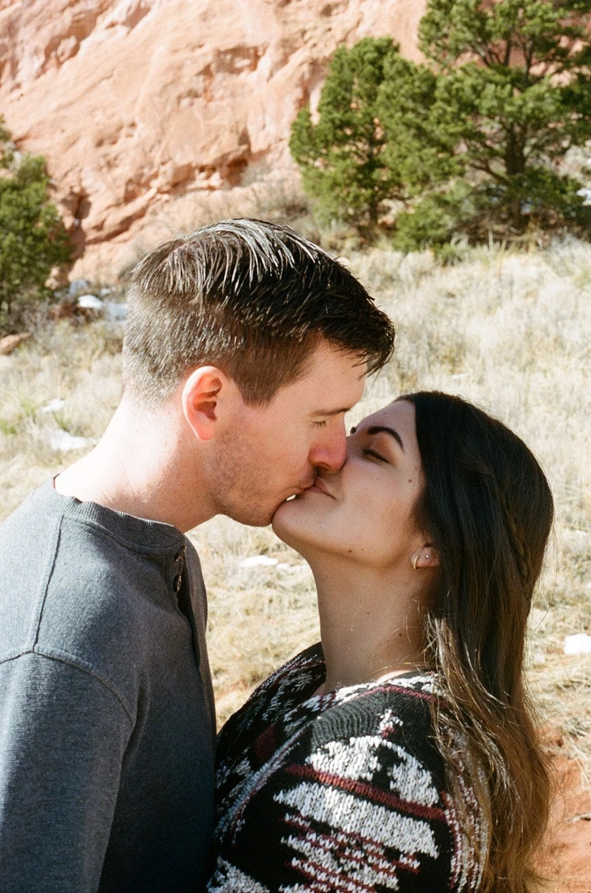 couple on film in garden of the gods colorado. Adventure among red rock and towers that will capture your imagination