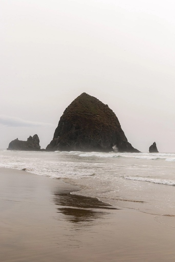 hatstack rock at canon beach on a cloudy afternoon in oregon