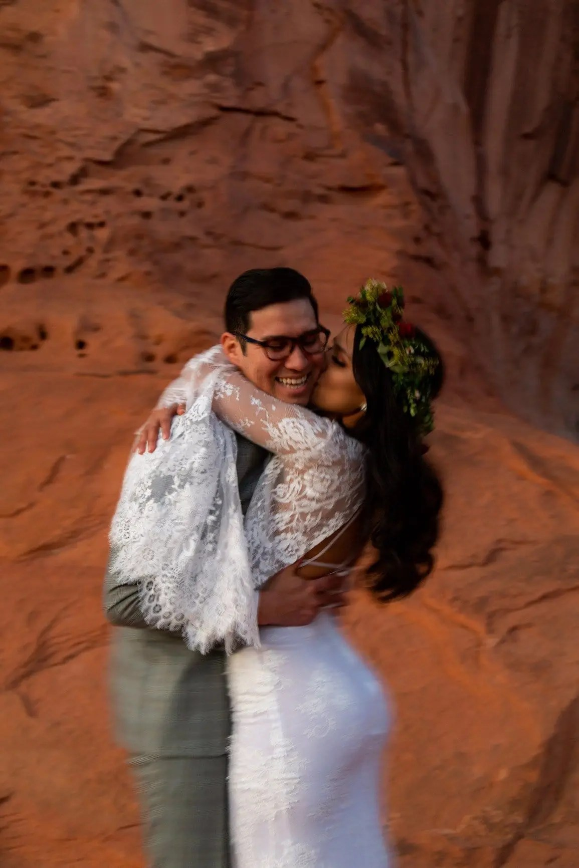 moab elopement couple kiss after their ceremony in moab