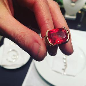Solid gold ring with red sapphire