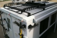 On Roof Camper & Hallmark-custom-roof-racks-yakima