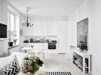 Scandinavian studio apartment with bright white interiors ...