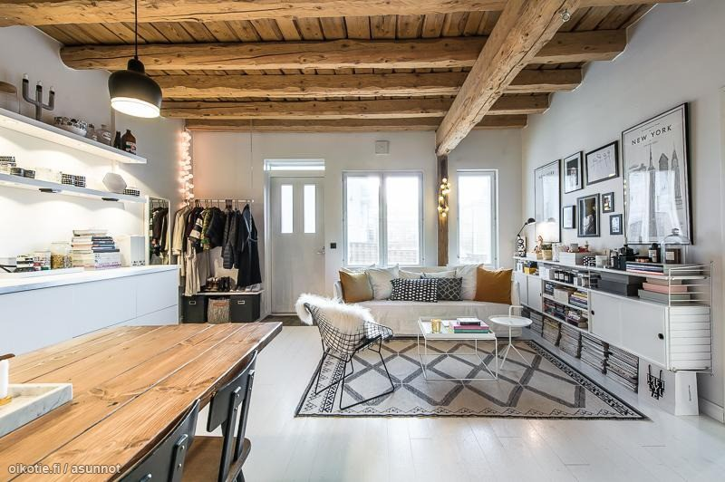 Modern white meets warm wood in this Finnish apartment