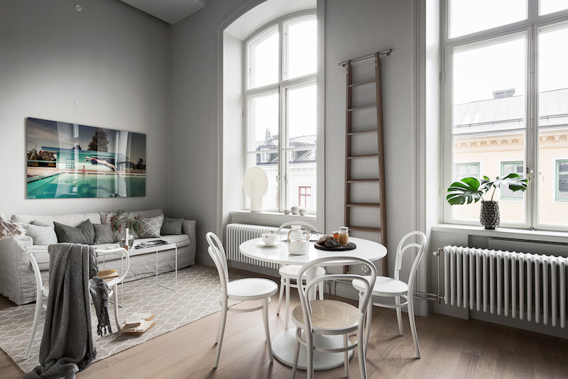 industrial style dining chairs rubber feet for metal chair legs small apartment in black and white with a loft bedroom | hall of homes