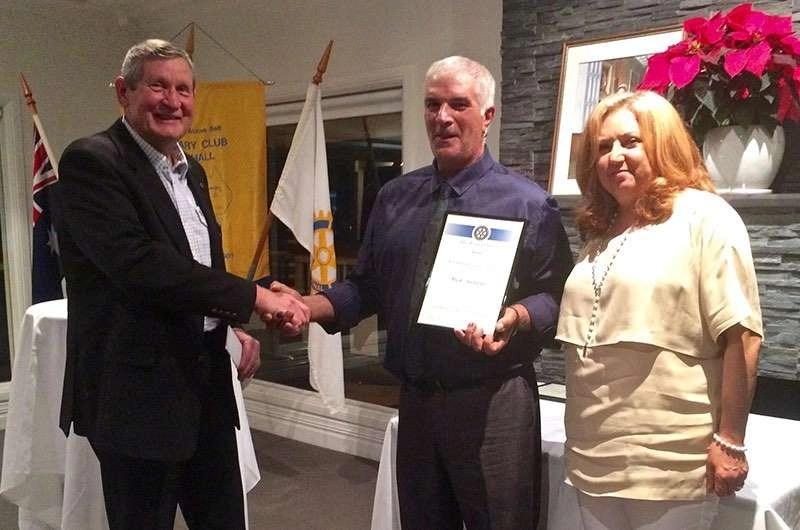 Mick and Rosa Addinno receive the Vocational Award from Rotary Club of Hall's Tony Howard