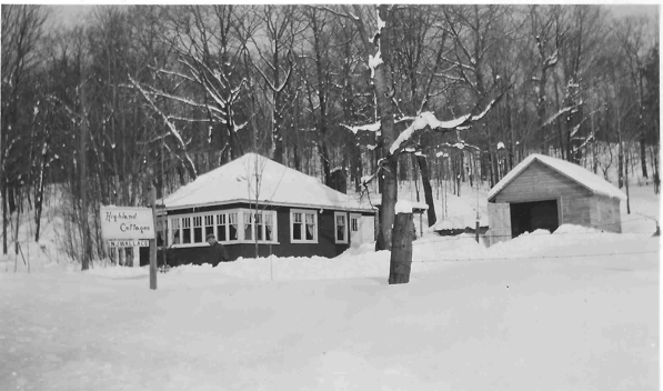 A cottage with many windows in winter