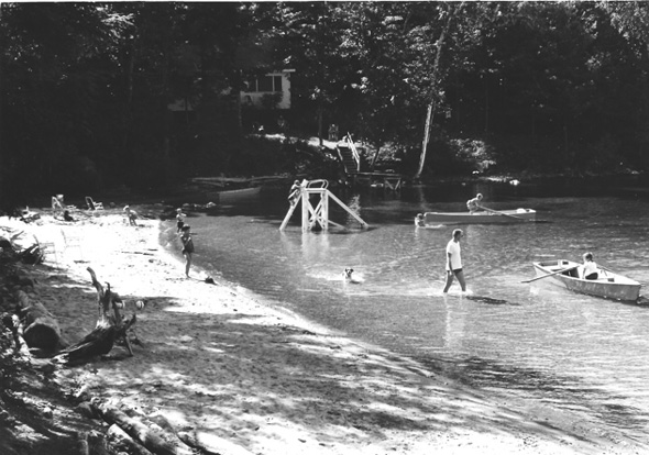Children and their parents in the lake shore