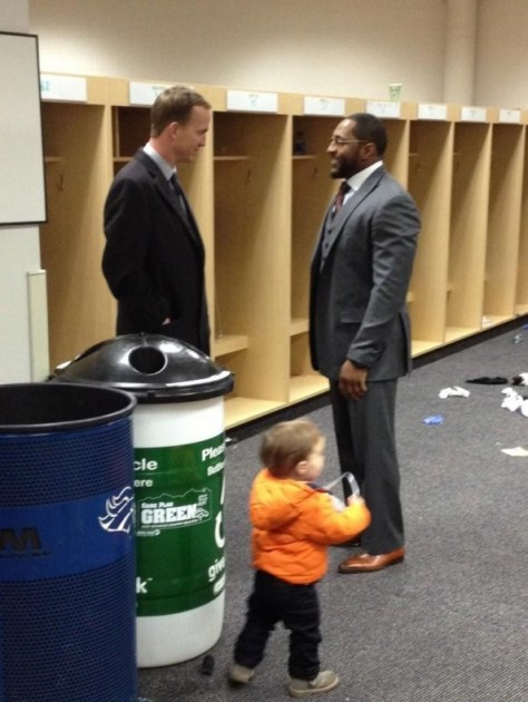 Manning and Ray Lewis after the double overtime loss in Denver