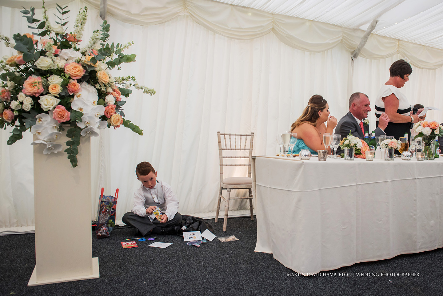 bored pageboy during wedding speeches