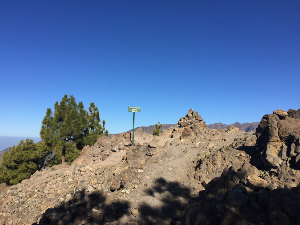 Arriving at the summit (with sign & cairn)
