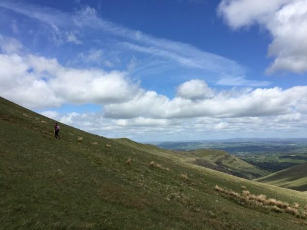 YL walking up the steep slope towards Pen Y Fan summit