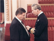 For services to victims of harassment, Hamish Brown receives the MBE from Prince Charles, the Prince of Wales