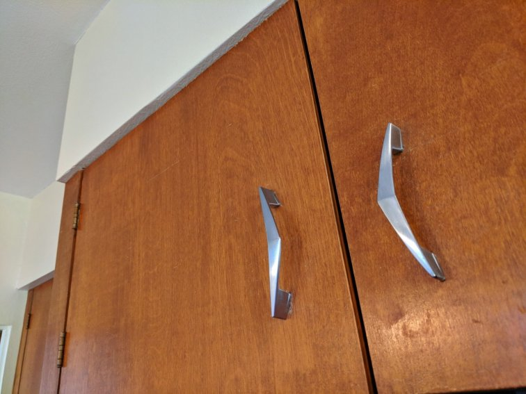 Boomerang hardware on mid-century modern cabinets