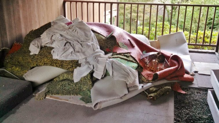 Pile of carpet, padding and drapes