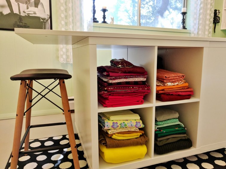 Craft room table with fabric storage