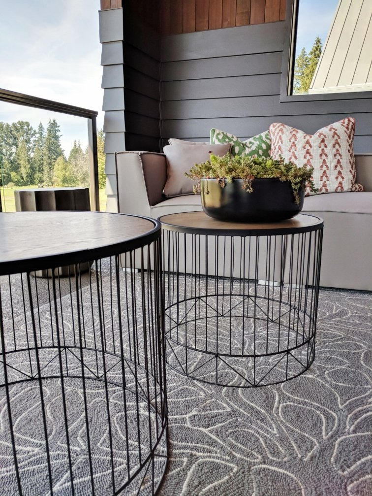 Outdoor side tables on modern deck