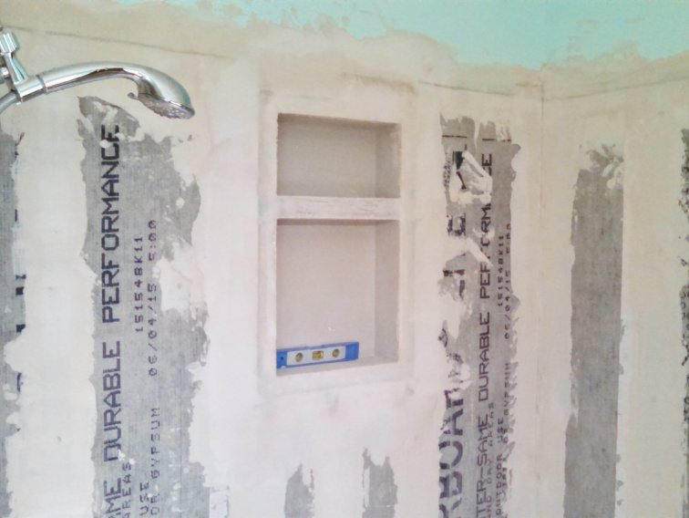 Add shower insert and seal cement board