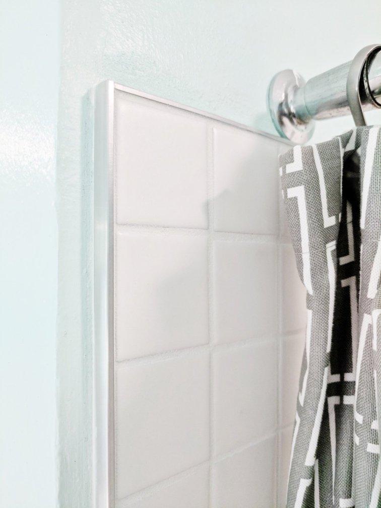 Tile edging around mid-century modern shower