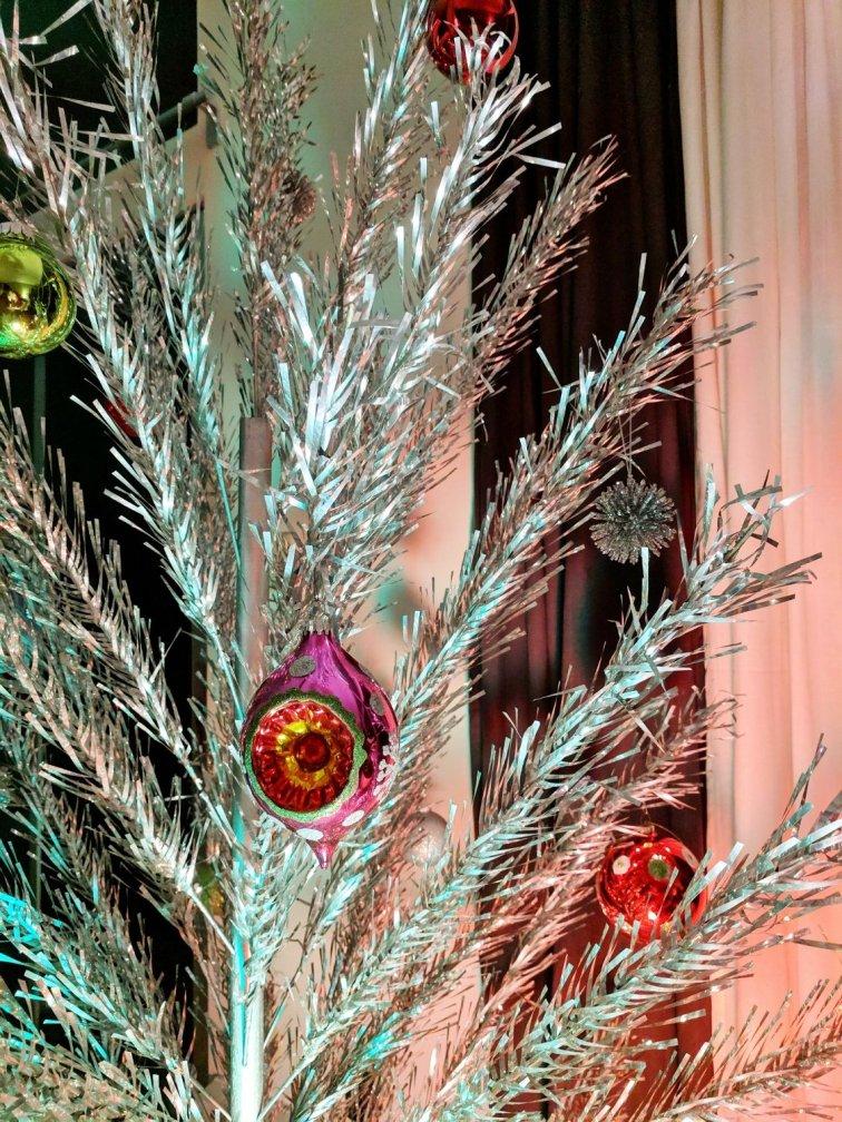 Mid-century modern aluminum Christmas tree with retro bulbs
