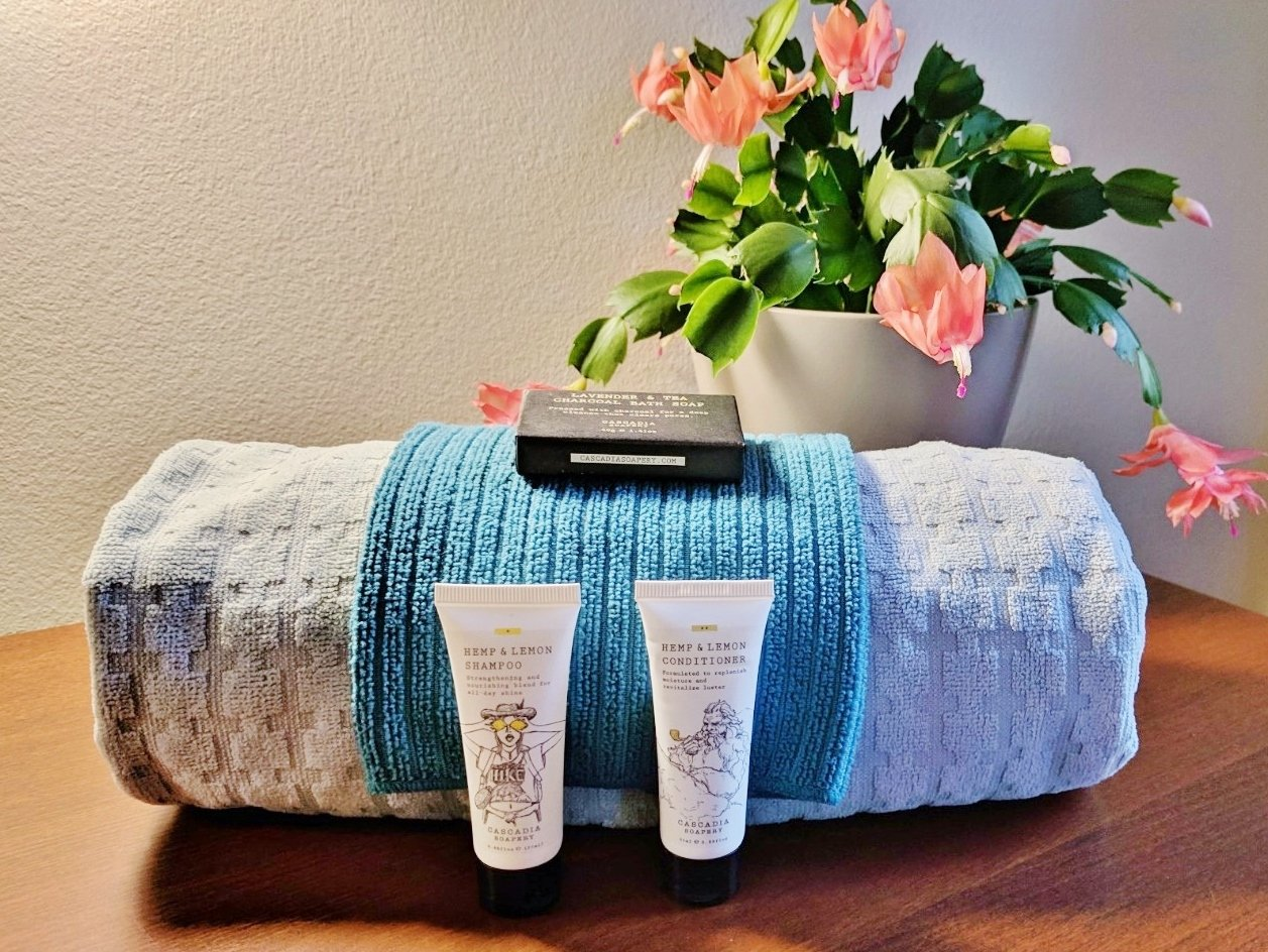 Towel and toiletries in pretty guest room