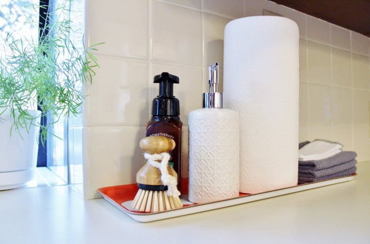 Clear the counters and group kitchen sink items on a tray for a quick tidying project