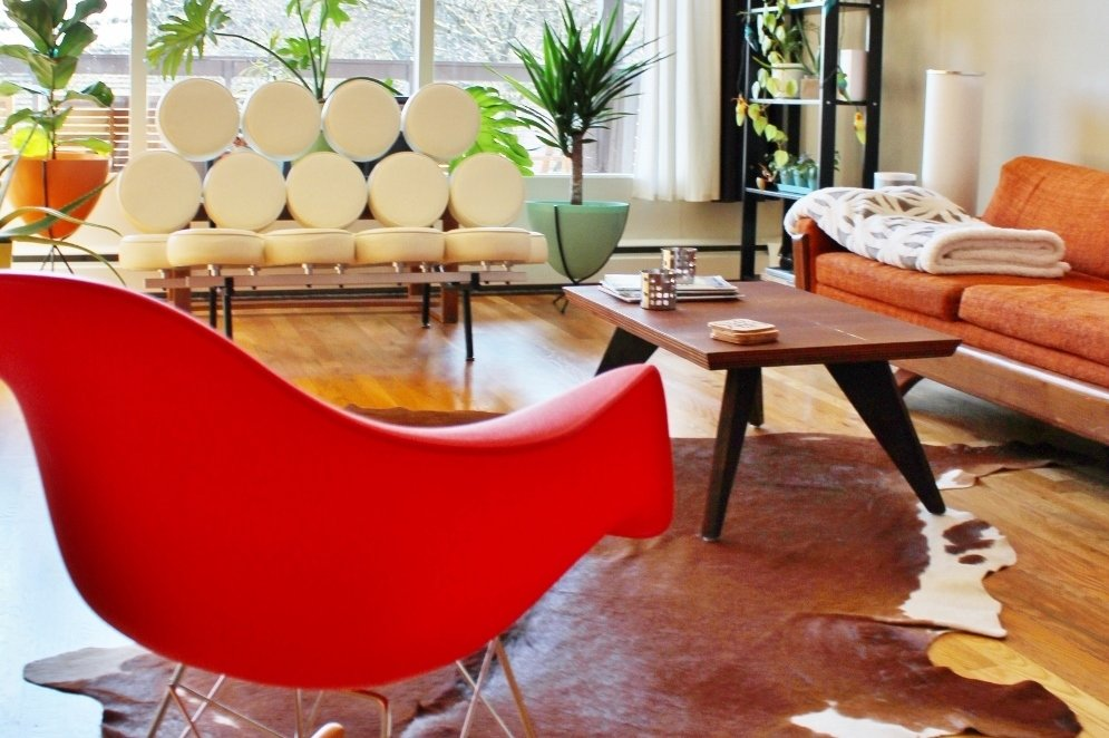 Red Eames style rocker in mid-century modern living room