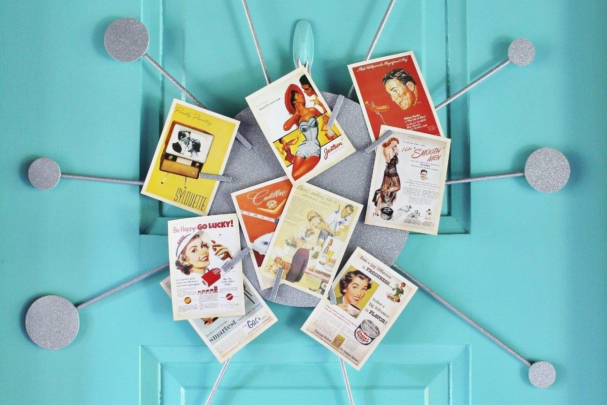 Retro postcard display on Sputnik card wreath