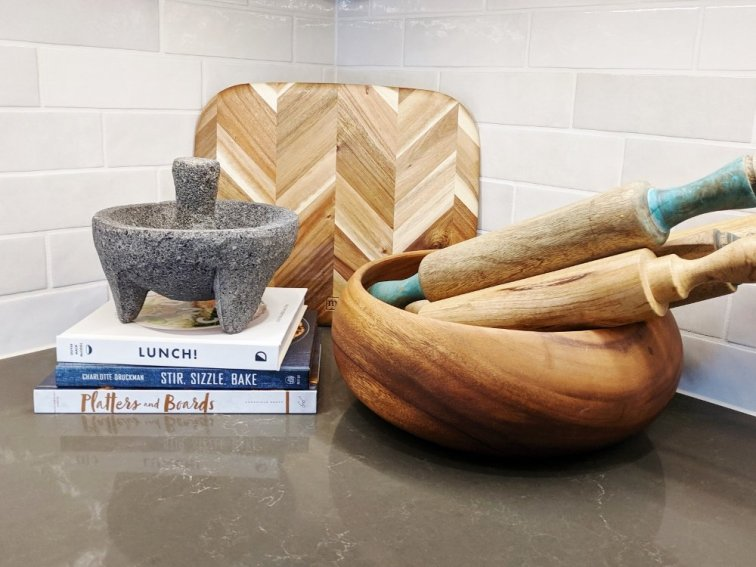 Collect rolling pins in a bowl for a pretty display