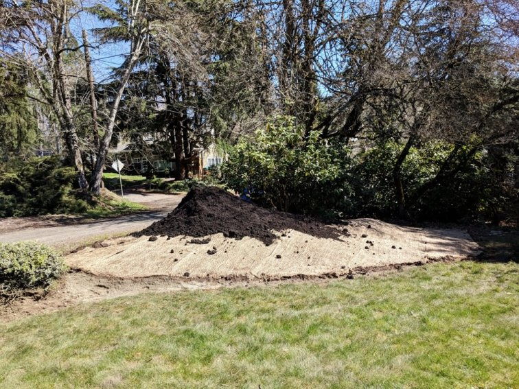 3 cubic yards of black mulch to finish DIY berm project