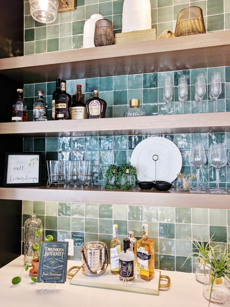 Well styled shelves stocked with bar supplies