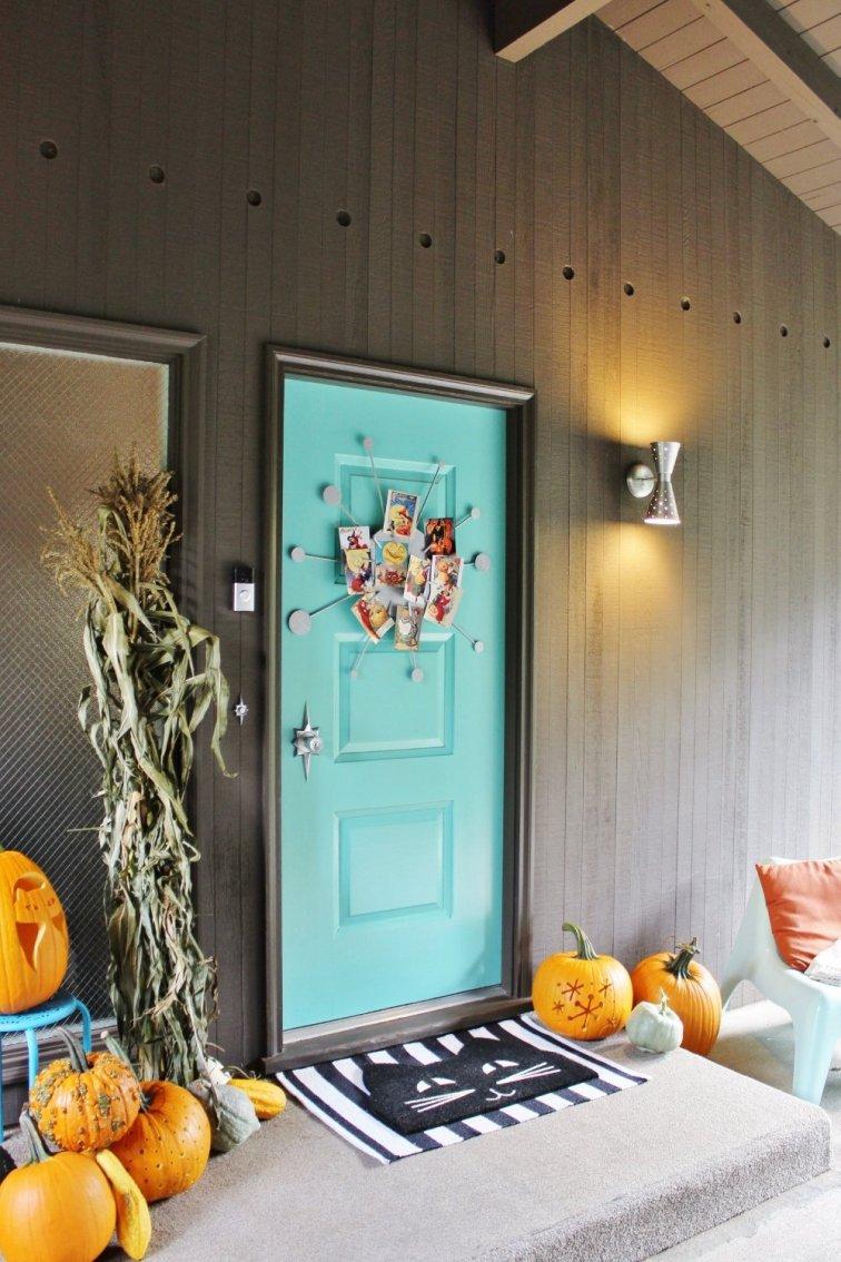 Mid-century modern front porch/breezeway with retro Halloween decor.