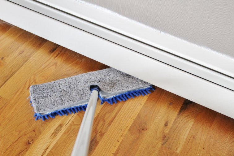 Microfiber dry mop duster used under baseboard heaters
