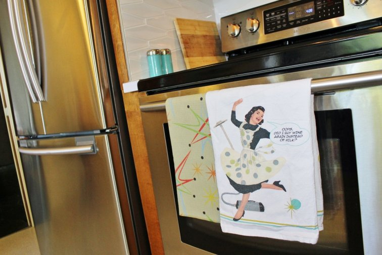 Mid-century modern kitchen towels hanging on stove