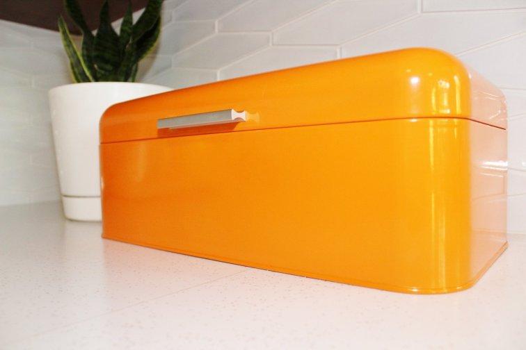 Orange bread box in mid-century modern kitchen