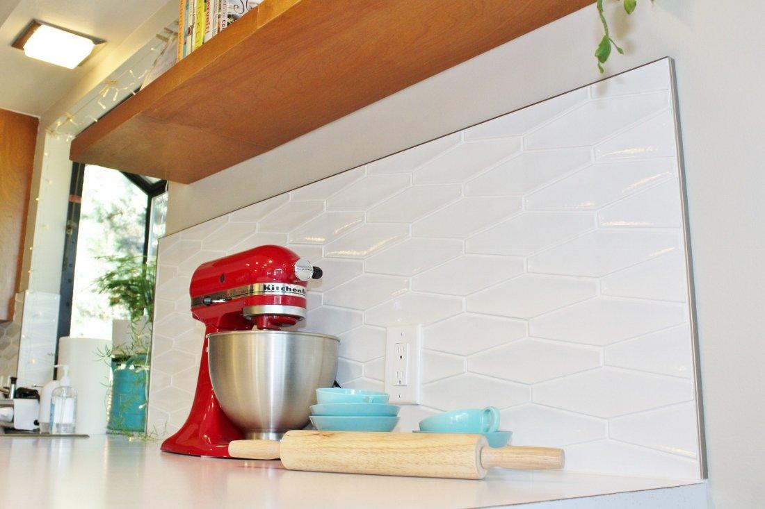Modern hexagon tile backsplash in mid-century kitchen