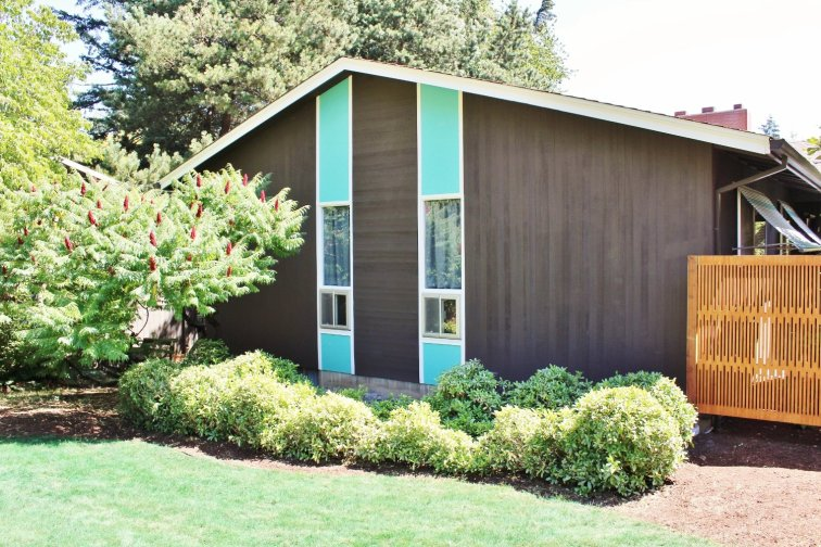 Turquoise and white trim on brown mid-century ranch house