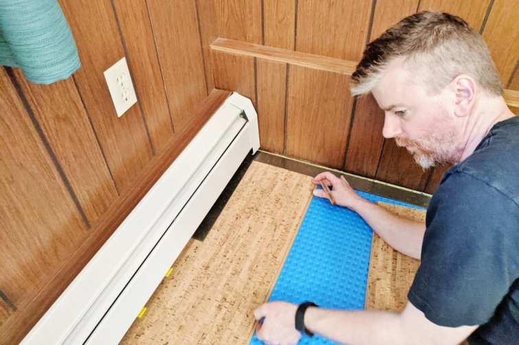 Measuring a cork flooring plank for cutting