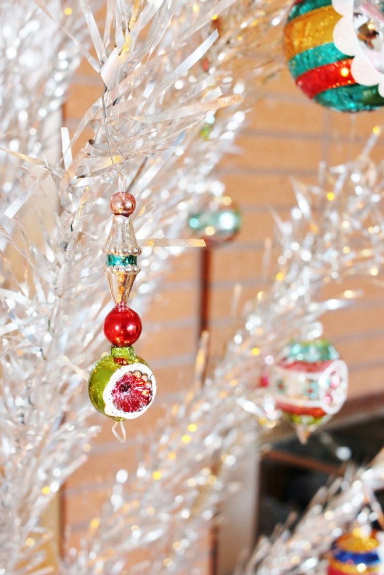 Colorful Shiny Brite ornaments displayed on vintage Christmas tree