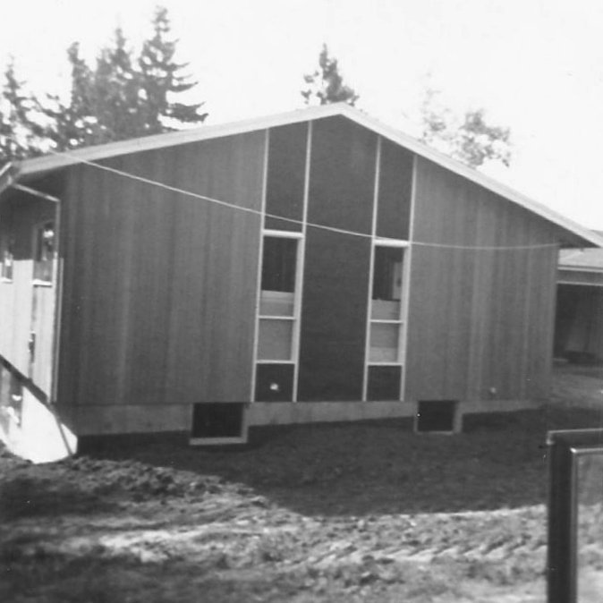 1960s ranch house with accent panels and cedar siding