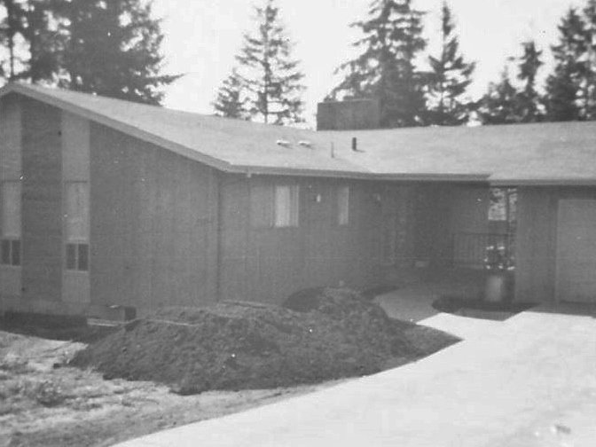 1960s ranch house being built with breezeway