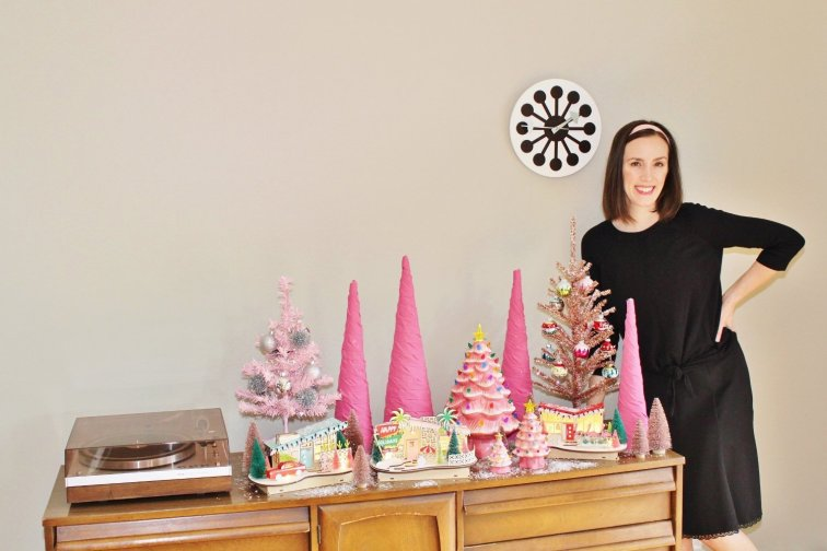 Pink Christmas tree village on mid-century modern sideboard