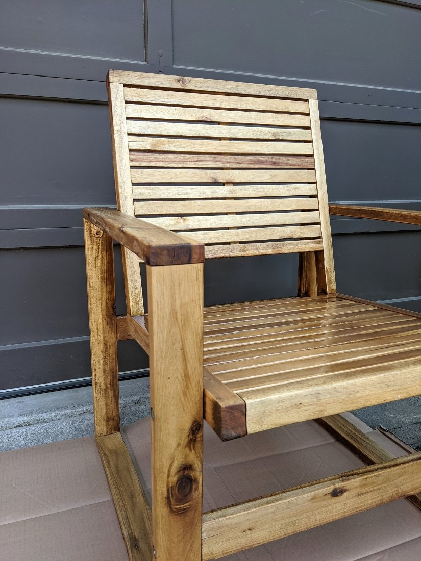Wood patio chair right after applying teak oil