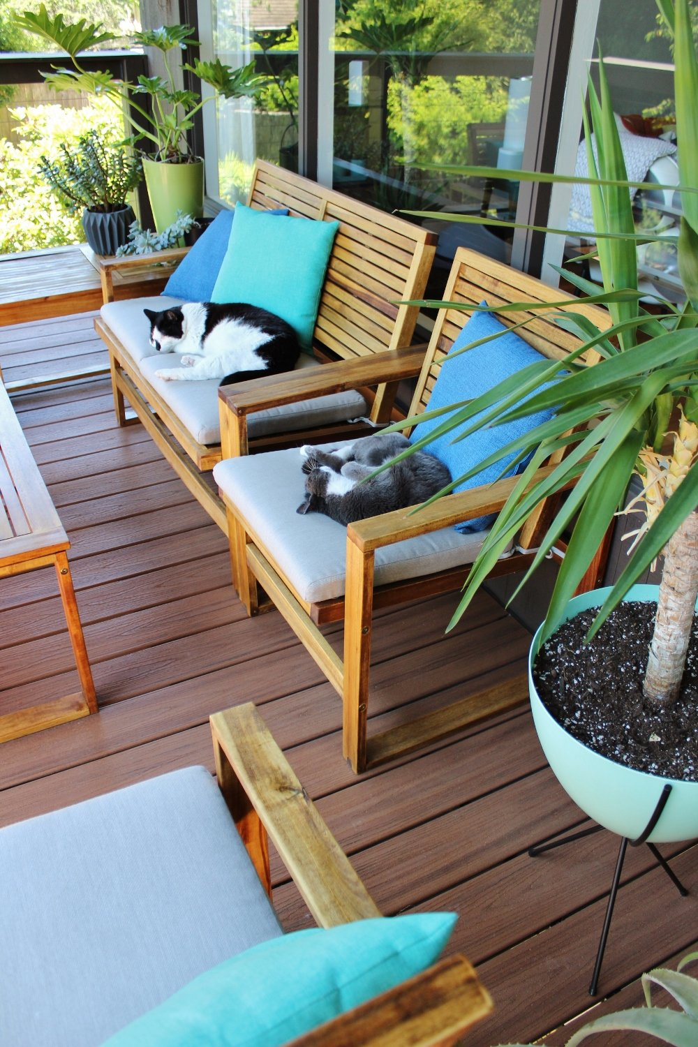 Outdoor furniture makeover with new cushions and teak oil finish