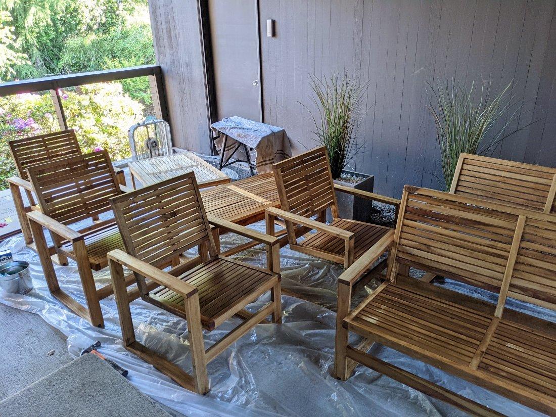 Wood patio furniture set with fresh coat of teak oil