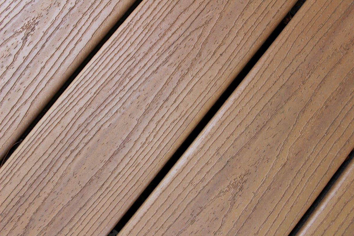 Closeup of tiki torch Trex deck boards