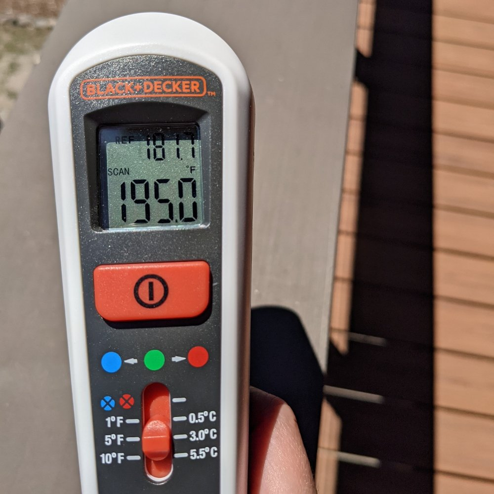 Temperature of wood deck handrail on 116-degree hot summer day