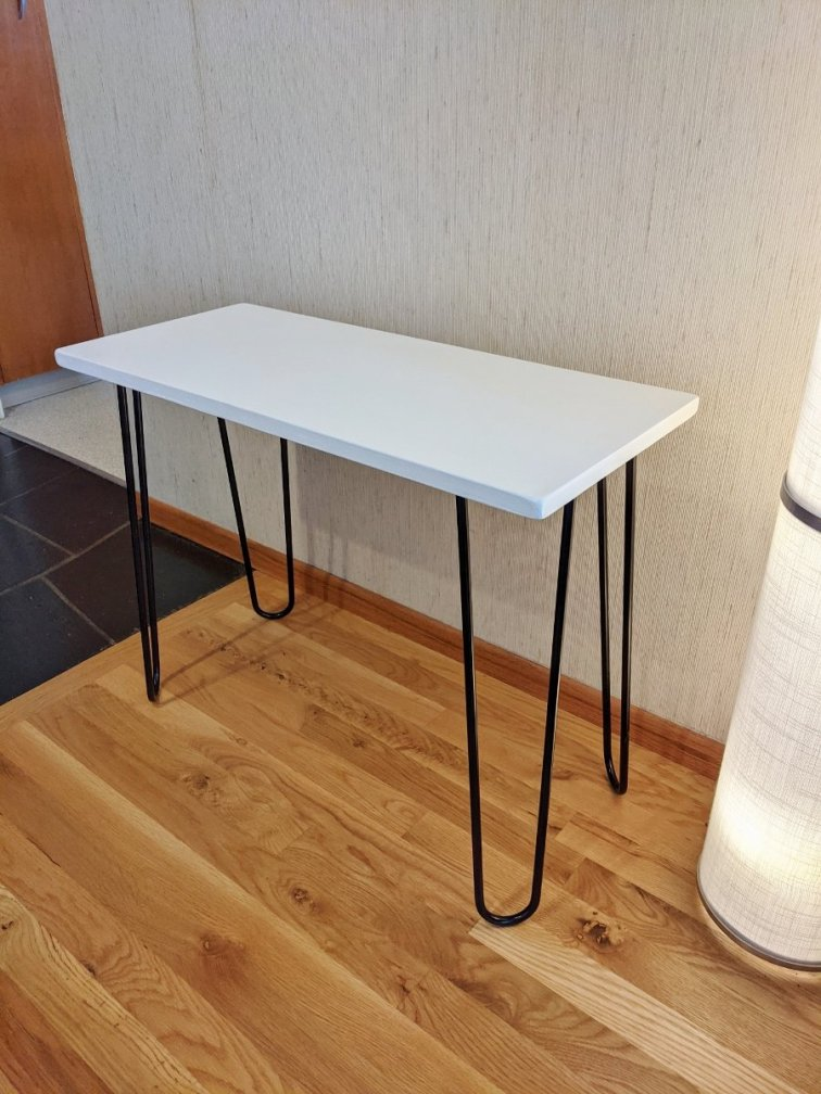 Mid-century modern plant stand can also be used as a side table