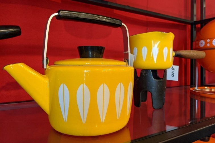 Yellow and white Cathrineholm teapot and butter warmer at LookModern store in Portland