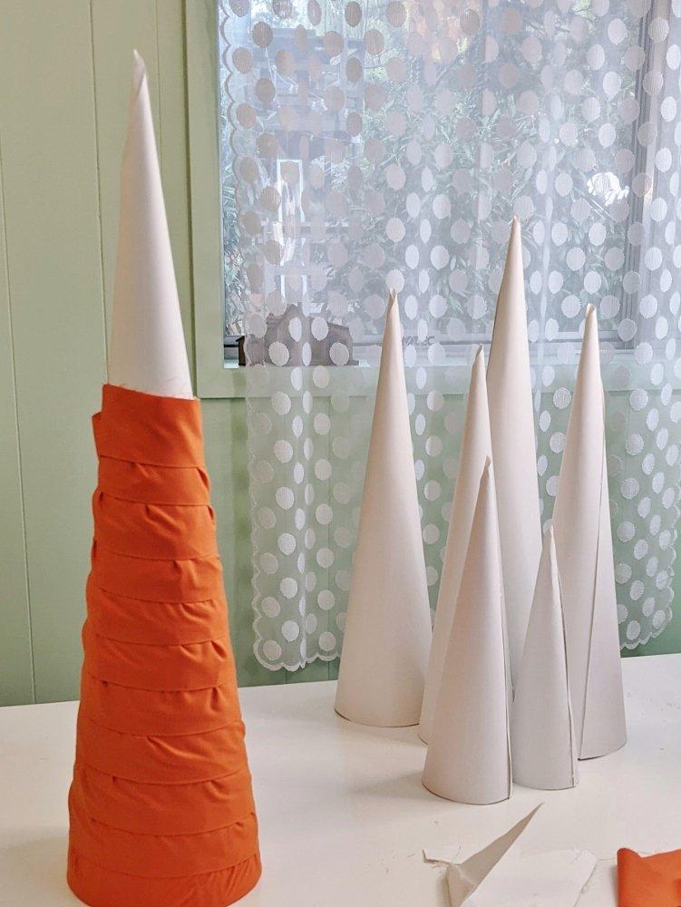 Making Halloween cone trees with orange fabric